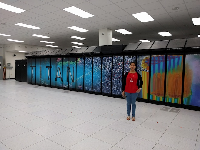 Lupe standing in front of a supercomputer