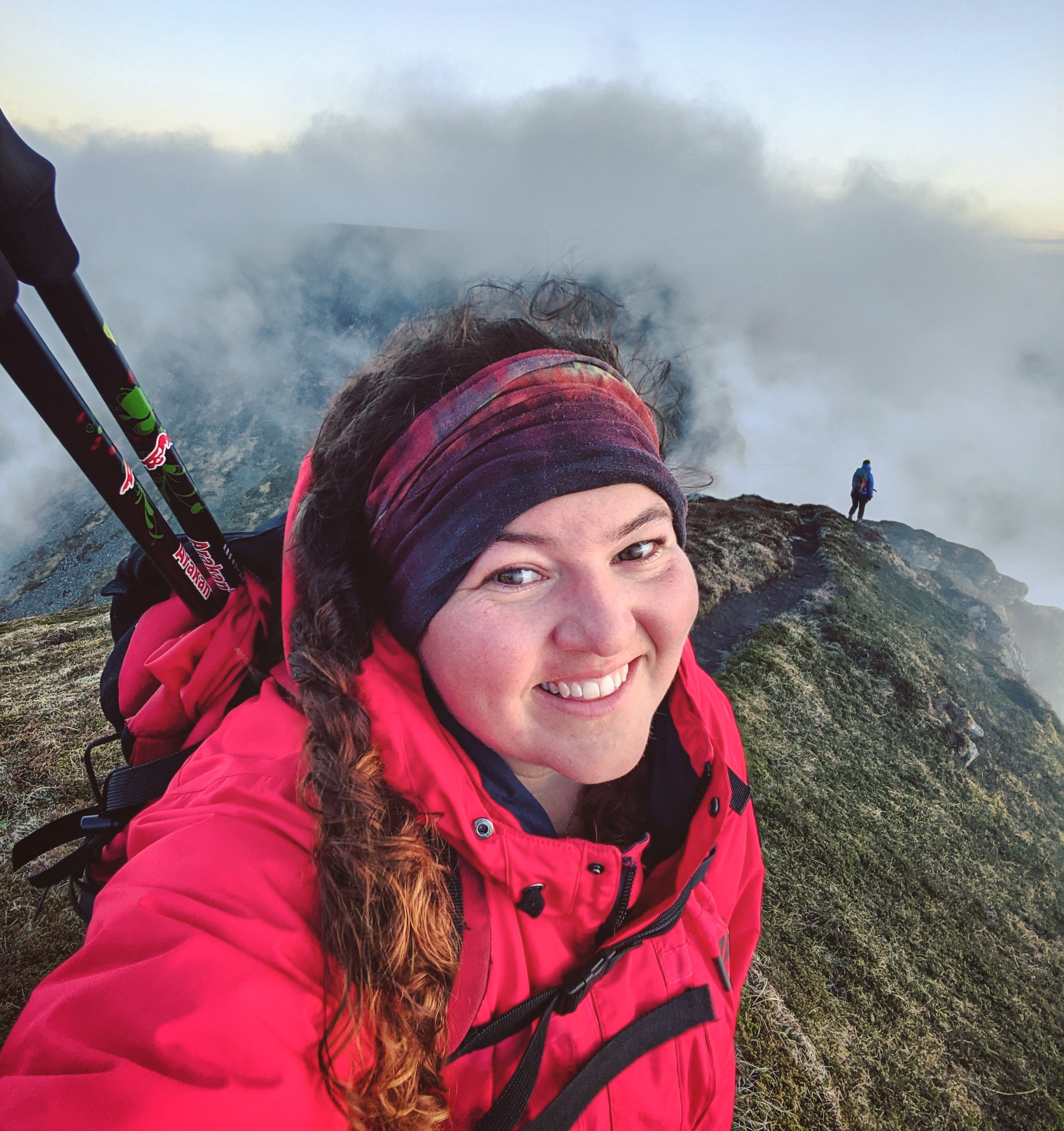 photo of Rebecca Robinson hiking on a mountain top
