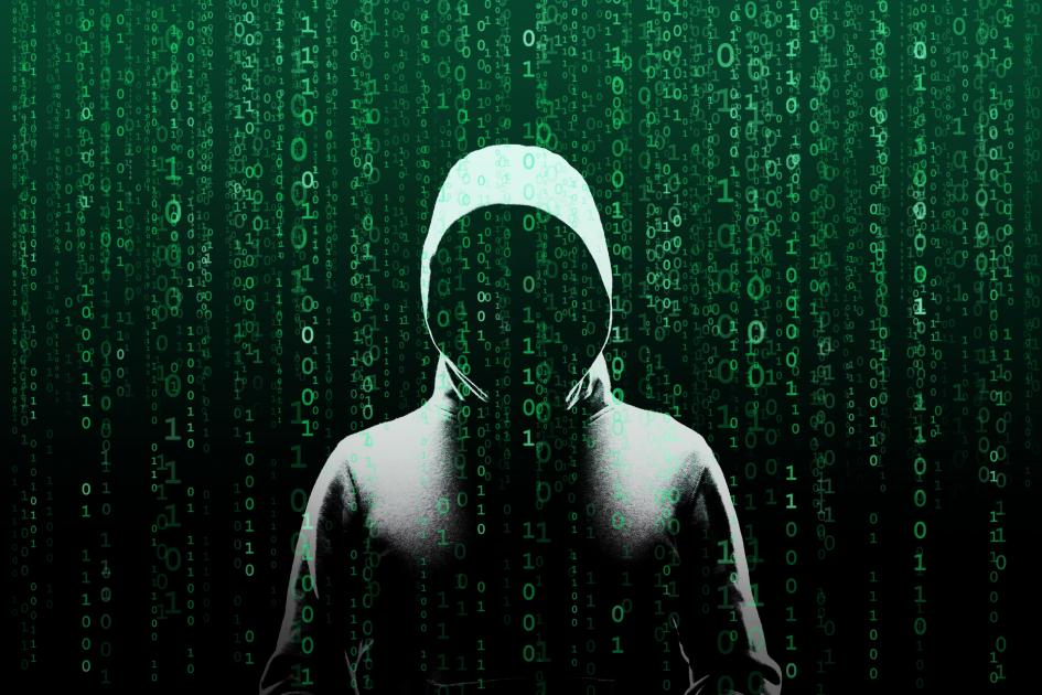 Anonymous computer hacker over abstract digital background